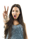 Real young woman winner pretty showing the sign of victory or success Royalty Free Stock Images