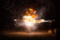 Realistic fiery explosion busting over a black background Royalty Free Stock Photo