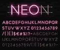 Realistic neon alphabet on a background of black brick wall. Bright glowing font. Vector format