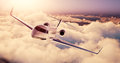 Realistic photo of White Luxury generic design private airplane flying over the earth at sunset. Empty blue sky with Royalty Free Stock Photo
