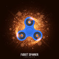 Realistic plastic blue spinner in the fire. Fiery speed. Bright flash of light with glare. Stress relieving toy. Modern toy for fi