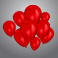 Realistic red birthday balloons flying for party or celebrations. Space for message. Isolated on light background.
