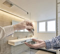 Realtor giving house key to buyer in luxury bathroom estate home Royalty Free Stock Image