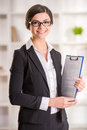 Realtor happy woman ready to show an apartment to clients Stock Photo