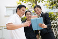 Realtor s job close up of a couple and a using a tablet outside Stock Photography