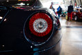 The rear brake lights of sports car Ferrari 599 GTB Fiorano F1, 2008. Royalty Free Stock Photo