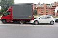 Rear end collision a in milan urban area italy the car failed to stop when the articulated lorry stopped at the traffic the car s Royalty Free Stock Photo