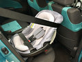 A rear facing infant seat baby properly installed in compact car Royalty Free Stock Image
