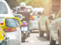 Rear mirror of taxi while jammed in traffic on road Royalty Free Stock Photo