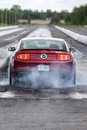 Rear mustang view napierville dragway canada may of red gt at the starting line during burnout at special event Stock Image
