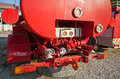 The rear of old red fire truck with water pump equipment Royalty Free Stock Images