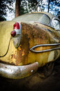 Rear of rusted old car end a yellow coupe from the s Royalty Free Stock Image