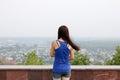 Rear shot of a young girl looking at the horizon Royalty Free Stock Photo