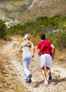 Rear view of an active couple jogging Royalty Free Stock Photos