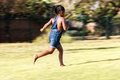 Rear view of african kid running. Royalty Free Stock Photo