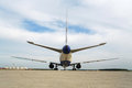 Rear view of airplane standing at aerodrome on runway Royalty Free Stock Image