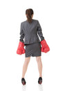 Rear view of Asian business woman with boxing gloves Royalty Free Stock Photo