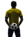 Rear view back man holding soccer football silhouette one caucasian in on white background Royalty Free Stock Photos