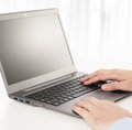 Rear view of business man hands busy using laptop at office desk with copyspace Royalty Free Stock Image