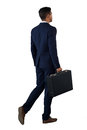 Rear view of businessman walking with briefcase Royalty Free Stock Photo