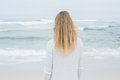 Rear view of a casual blond at beach young standing the Stock Photo