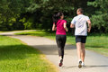 Rear view of caucasian runners outdoors female and male Stock Photo