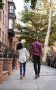 Rear View Of Couple Walking Along Urban Street In New York City Royalty Free Stock Photo