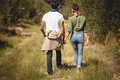 Rear view of couple walking at olive farm Royalty Free Stock Photo