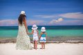 Rear view of fashion young mother and two her kids at exotic beach on sunny day this image has attached release Royalty Free Stock Photos