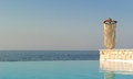 Rear view of greek style woman near infinity pool Royalty Free Stock Photo