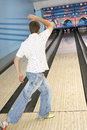 Rear view of a man bowling full length young Royalty Free Stock Images