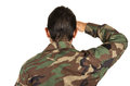 Rear view of man in military uniform saluting Royalty Free Stock Photo