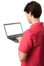 Rear view of man using laptop with blank screen Royalty Free Stock Images