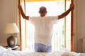 Rear View Of Man Waking Up In Bed In Morning Royalty Free Stock Photo
