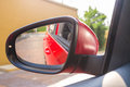 Rear view mirror of car in daylight for vacation trip Royalty Free Stock Photo