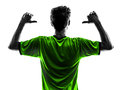 Rear view portrait soccer football player young man pointing si one in silhouette studio on white background Royalty Free Stock Image