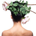 Rear view portrait of the woman with pink flowers in hair Stock Photos
