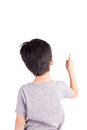 Rear view of a school boy over white background pointing upwards half length portrait Stock Images