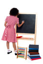 Rear view of school girl in maths class back pose a finding solution and solving problems Stock Photo