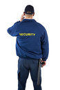 Rear view of security officer listening to earpiece Royalty Free Stock Photo