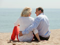 Rear view of senior man and mature woman together men women against sea in summer Royalty Free Stock Photography