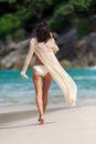 Rear view of sexy slim woman walking at a beach tropical in thailand Royalty Free Stock Photo