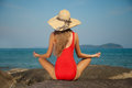 Rear view sexy woman red bikini hat meditation relaxing concept Royalty Free Stock Image