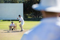 Rear view of umpire standing at cricket match field Royalty Free Stock Photo