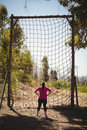 Rear view of woman looking at net during obstacle course Royalty Free Stock Photo