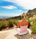 Rear view of a woman meditating in outdoors Stock Photography