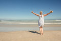 Rear view of woman standing on sand against clear sky Royalty Free Stock Photo