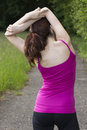 Rear view of a woman stretching outdoors rearview in nature Stock Photography