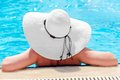 Rear view of a woman into swimming pool the Royalty Free Stock Photos