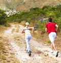 Rear view of a young couple jogging Stock Photo